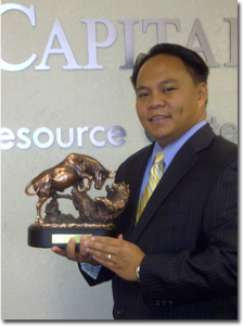 gilbert-garcia-with-bull-and-bear-award